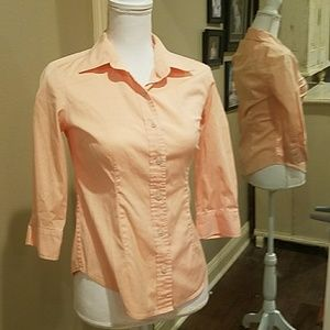 A  3/4 length sleeve button up front peach top